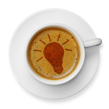 Light bulb icon on coffee